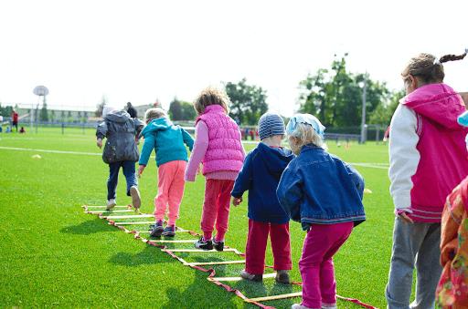 Kid's Team Building on Green Grassland