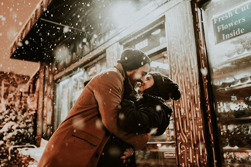 Man and woman hugging each other in a cold weather