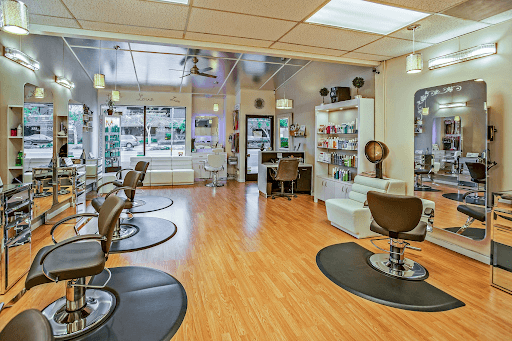 white and black chairs inside a salon (beauty bar image)