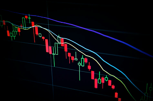 red and blue light streaks indicating the rise and fall of the stock marke