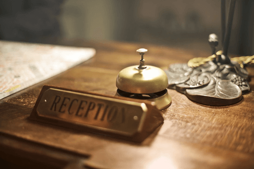 Reception desk with an antique hotel bell