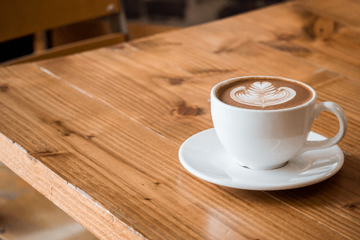 Photo of a cup of coffee on a wooden table