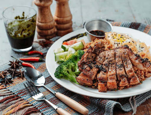 Photo of grilled barbecue on a plate with vegetables