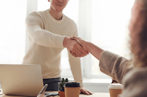 A man and a woman shaking hands