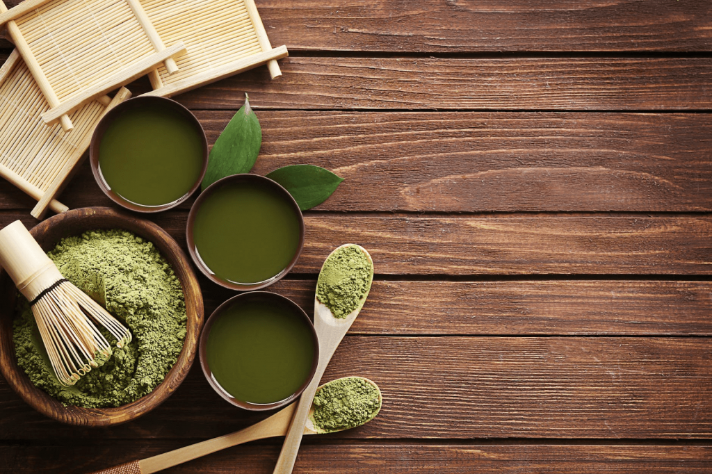 green tea set in a wooden table