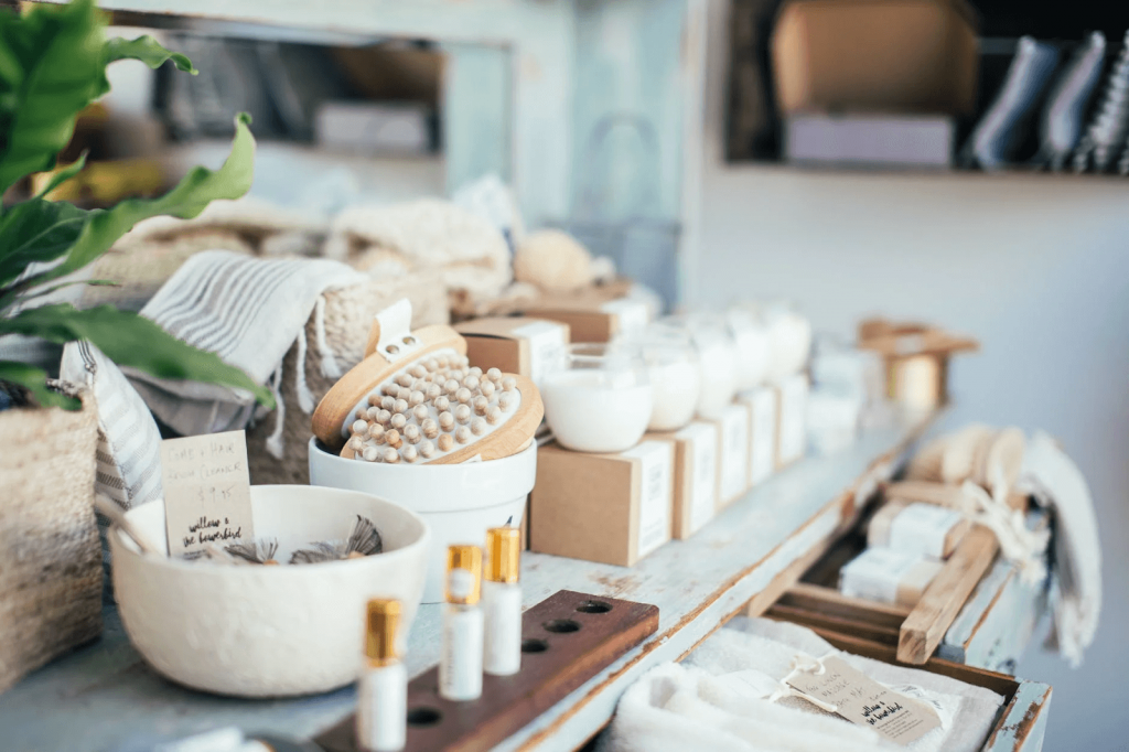 perfume, brushes, and aromatic candles (cosmetics shop image)