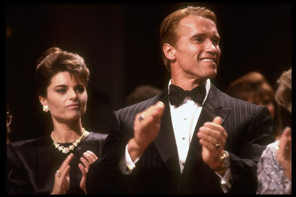 Arnold Schwarzenegger and wife Maria Shriver in black formal outfits for a Reagan event