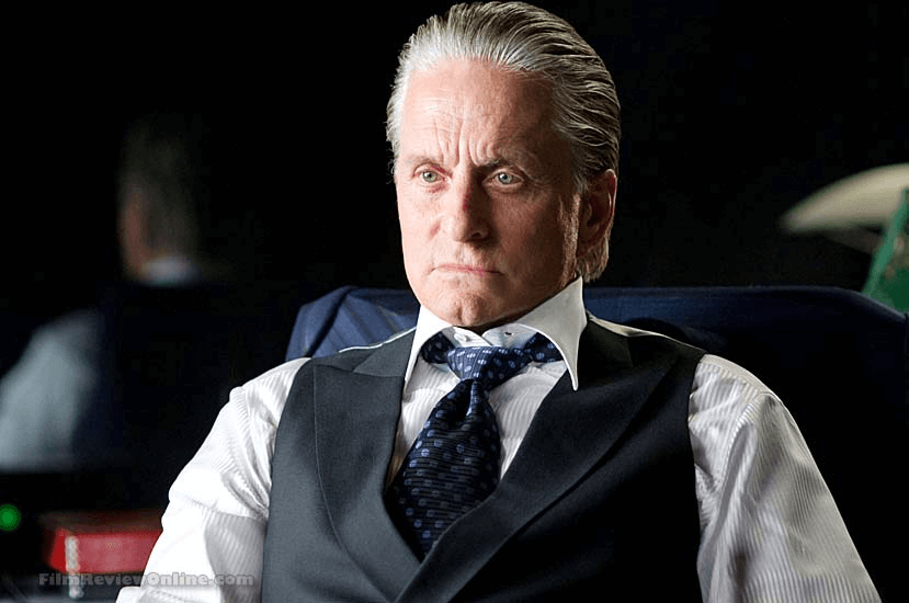 Old Gordon Gekko on a while long-sleeve polo and a black vest