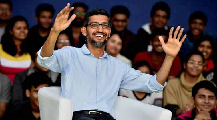 Sundar Pichai with a wide smile while raising both his arms