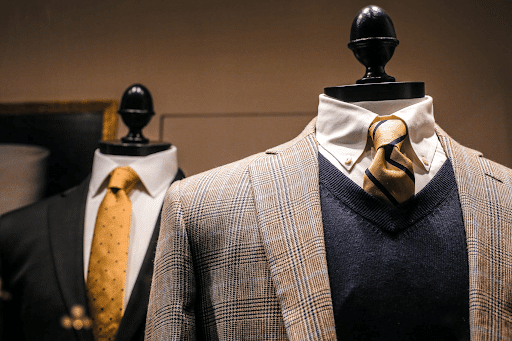 Elegant male suits on dummies in a modern boutique