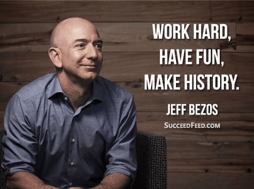 """Jeff Bezos on a grey long-sleeve polo and the quote """"Work hard, have fun, make history"""""""