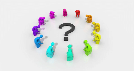 A group of seated people surrounding a big question mark at the center.