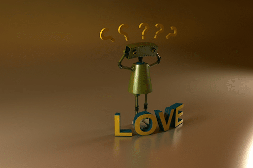 A small robot with his hands on his head standing near a LOVE sign