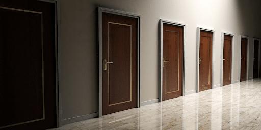 Photo of brown doors in a hallway