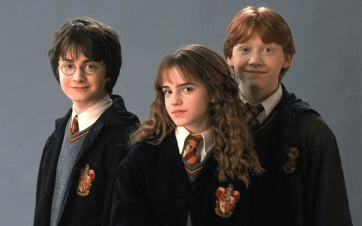 Harry, Hermione, and Ron wearing their Hogwarts uniforms