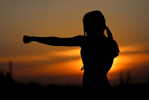 Silhouette of a woman practicing karate