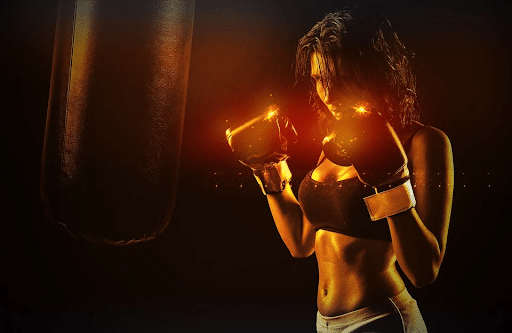 Girl boxer in front of a punching bag