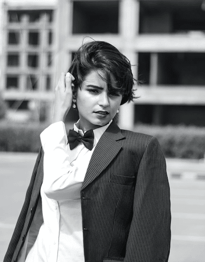 a short hair woman with a suit