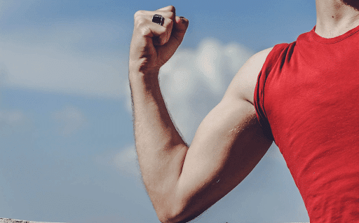 Man raising his right arm with a clenched fist