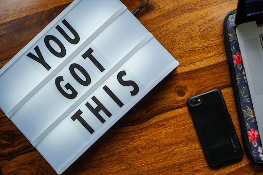 A cellphone and a changeable signage board that says 'You got this'