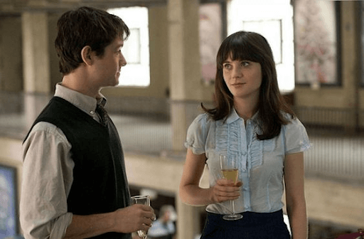 Tom and Summer holding a glass of drink each looking at each other