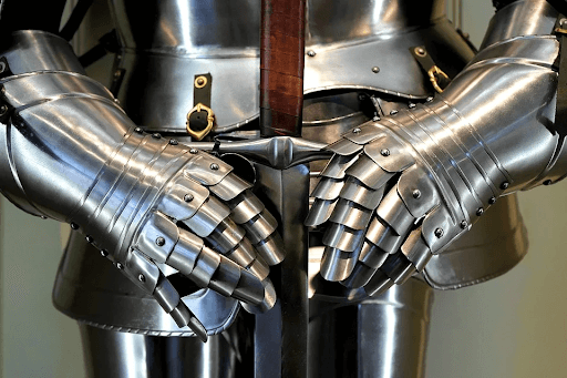 Gray medieval knight armor holding a sword