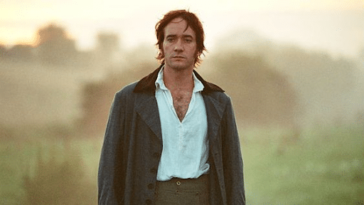 Mr. Darcy wearing a white top and grey coat with a seemingly sad face