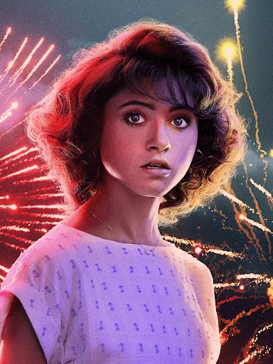 Nancy Wheeler with fireworks behind