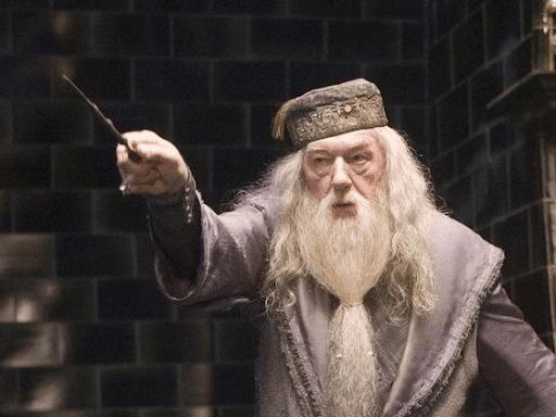 Upset Dumbledore pointing his wand onto something