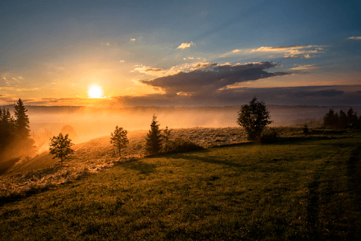 Sunset at the top of a foggy mountain