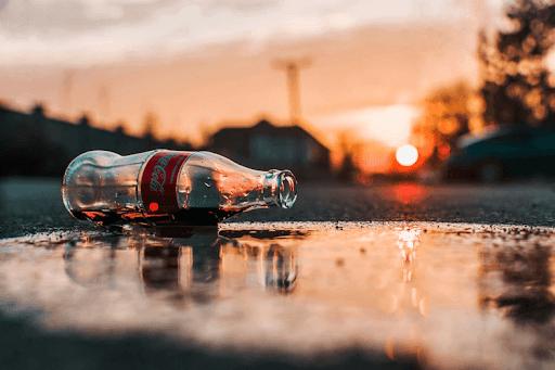 Coca Cola Bottle On Pavement