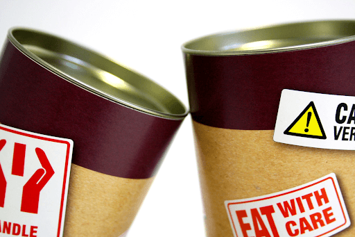 Two cans with warning signs