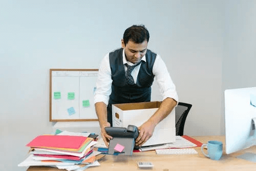 Man Packing His Desk
