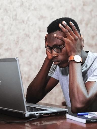 : Man Working Using a Laptop