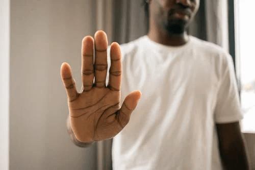 Unrecognizable Black Man Showing Stop Gesture