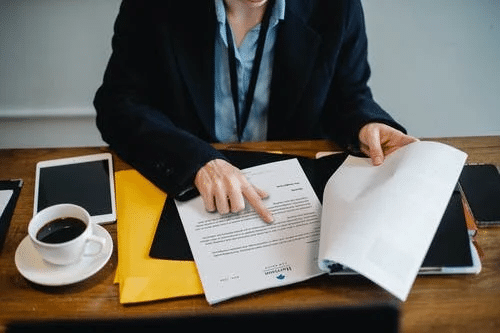 Crop Businesswoman Working with Documents