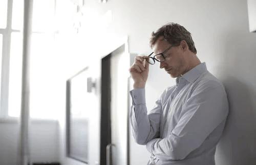 Photo of Man Holding Black Glasses