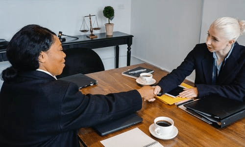 Cheerful Colleagues Shaking Hands in Office